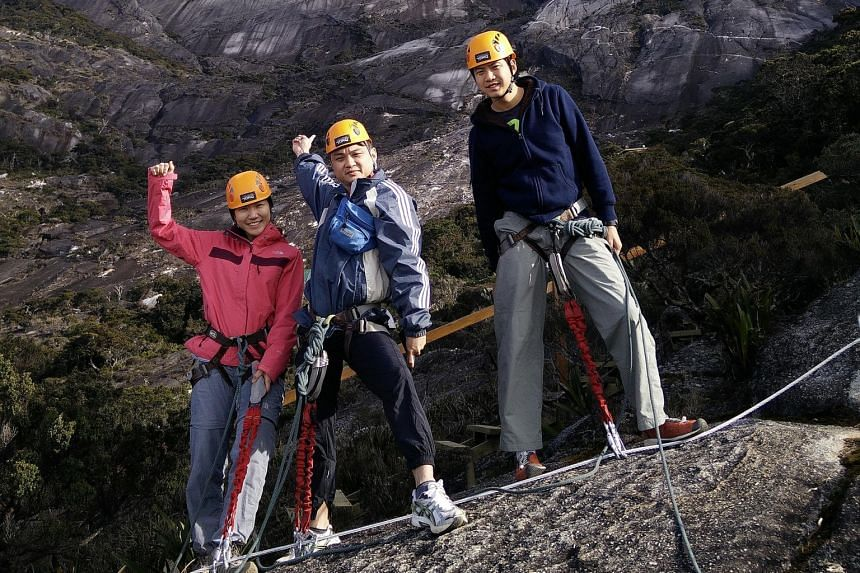 Ex-colleagues (from left) Tan Ken Li, Ang Chee Leng and Adrian Kok are among the latest from Singapore to climb Mount Kinabalu. The earthquake there killed 18 in June.