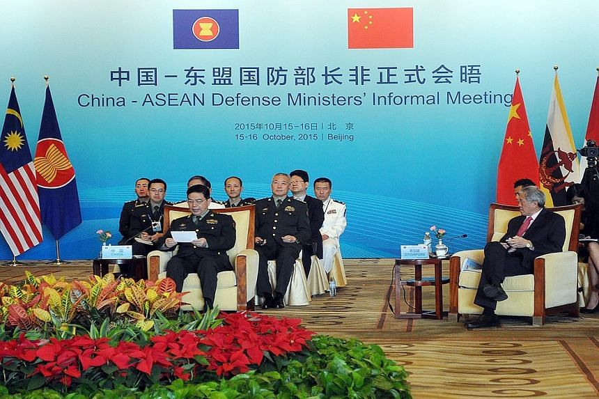 Dr Ng Eng Hen (right) and China's Defence Minister Chang Wanquan (left, front row) at the inaugural China-Asean defence ministers' informal meeting in Beijing yesterday. Dr Ng emphasised the need for Asean and China to keep working together to mainta