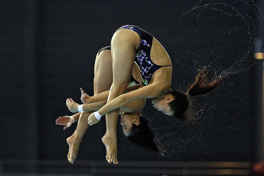 Singapore's Freida Lim (front) and Myra Lee gave home fans plenty to shout about when they came up with their best-ever score in finishing fourth in the synchronised 10m platform.