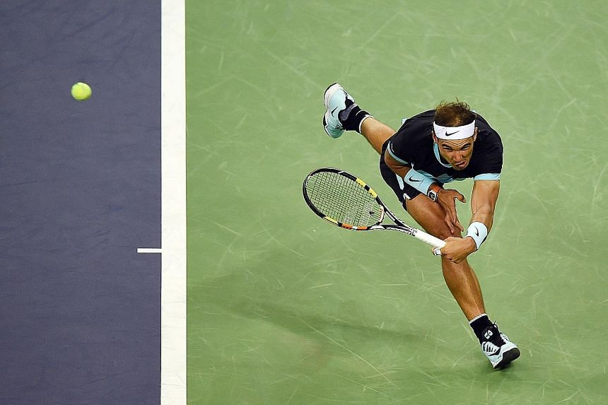 Rafael Nadal of Spain stretching deep for a return during his dominant quarter-final win over Stanislas Wawrinka of Switzerland at the Shanghai Masters yesterday.