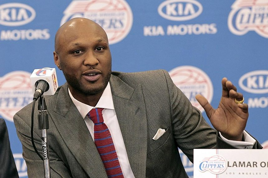 Former NBA player Lamar Odom, pictured while living the Hollywood lifestyle as the subject of the 2011 reality TV show Khloe and Lamar. The one-time Lakers forward remains in a coma after a drug overdose, after being found unconscious in a brothel.