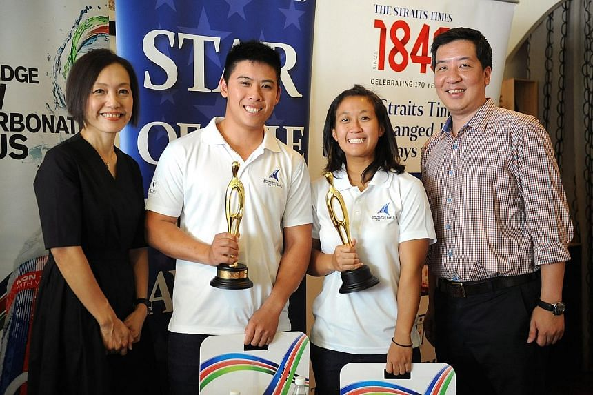 Sailors Justin Liu and Denise Lim are winners of The Straits Times Star of the Month for September. With them are F&N Foods general manager Jennifer See and ST sports editor Marc Lim. Liu and Lim (far right) became the first Singaporeans to triumph a