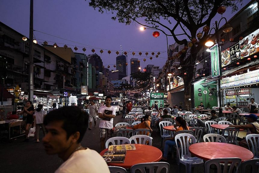 Jalan Alor, a popular food street in Kuala Lumpur. Issues such as cost of living, unemployment, and the impact of the goods and services tax, levied in April, topped Malaysians' list of grouses in Merdeka Centre's latest poll.