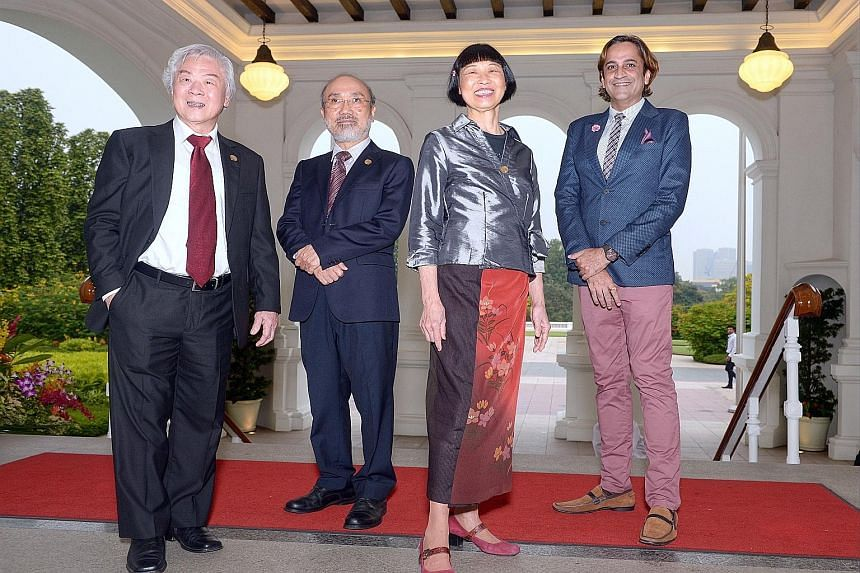 (From left) Painter Chua Mia Tee, writer Lin Gao, virtuoso pianist Margaret Leng Tan and dramatist Haresh Sharma received the Cultural Medallion yesterday at the Istana.