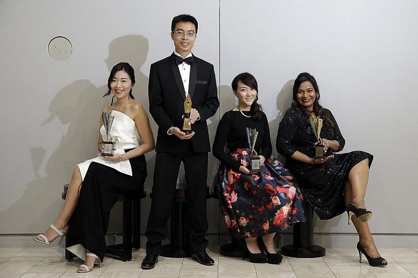 SPH journalists (from left) Shen Yue, Cai Haoxiang, Rachael Boon and Anita Gabriel swept most of the financial reporting awards last night.