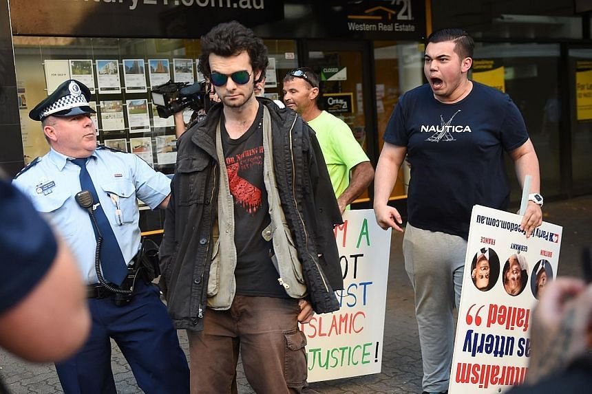 An anti-Muslim protester (right) shouting at a Muslim supporter during a demonstration outside the Parramatta Mosque in Sydney on Oct 9.