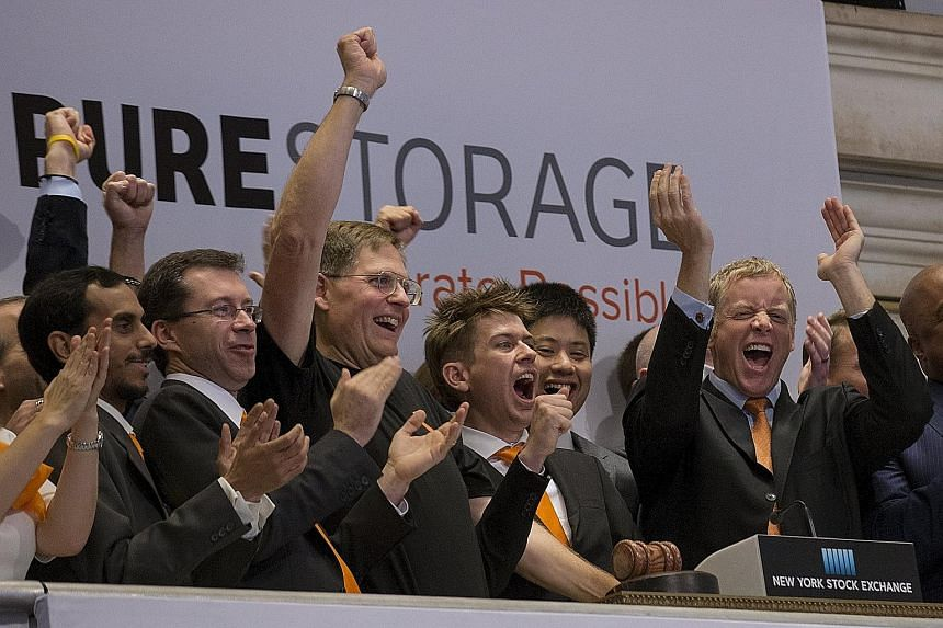 Pure Storage chief executive Scott Dietzen (at far right) and company officials celebrating its IPO at the New York Stock Exchange on Oct 7. Affected by the weaker venture investing climate this year, the offering took its market cap to a level that