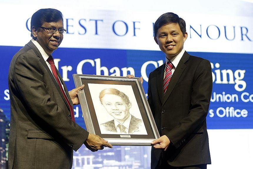 Mr David Gerald (left), president and chief executive of the Securities Investors Association (Singapore), presenting a token of appreciation to Minister in the Prime Minister's Office Chan Chun Sing, who was guest of honour at the 16th Investors' Ch
