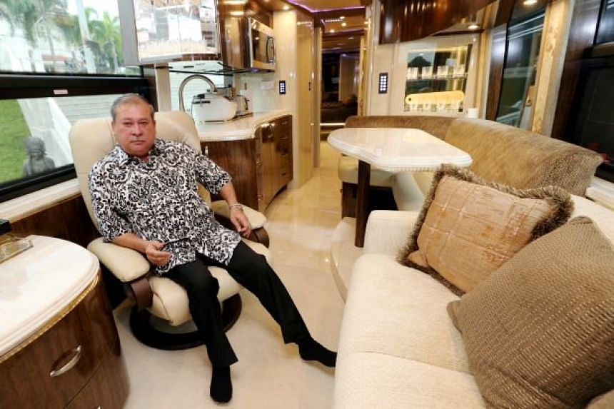 A file photo of Sultan Ibrahim Ismail in a luxury bus.