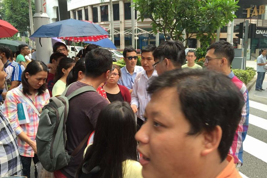 Myanmar nationals in the queue at Tanglin Road on Saturday.