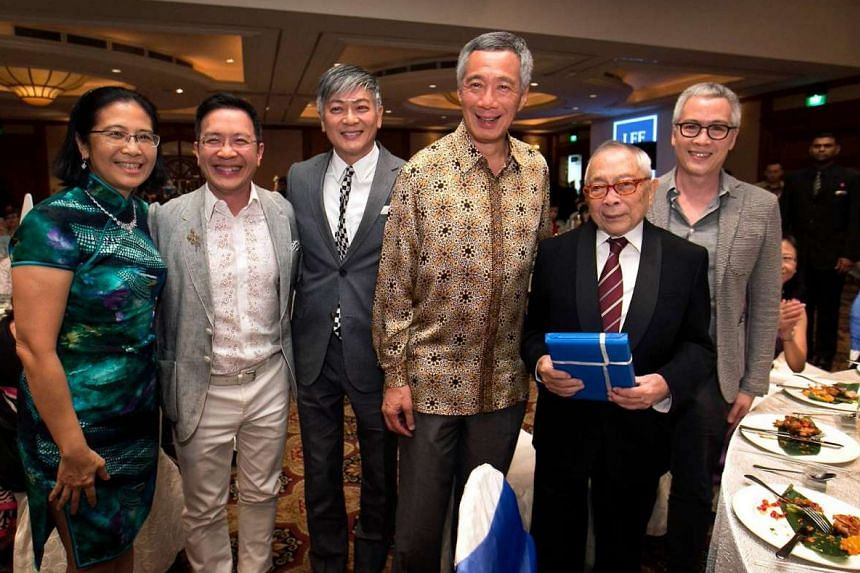Celebrating at law firm Lee & Lee's 60th anniversary dinner on Thursday were (from left) Lee & Lee managing partner Kwa Kim Li; Mr John Lee – the brother of singer-composer Dick Lee, who is next to him; Prime Minister Lee Hsien Loong; Mr Lee Kip