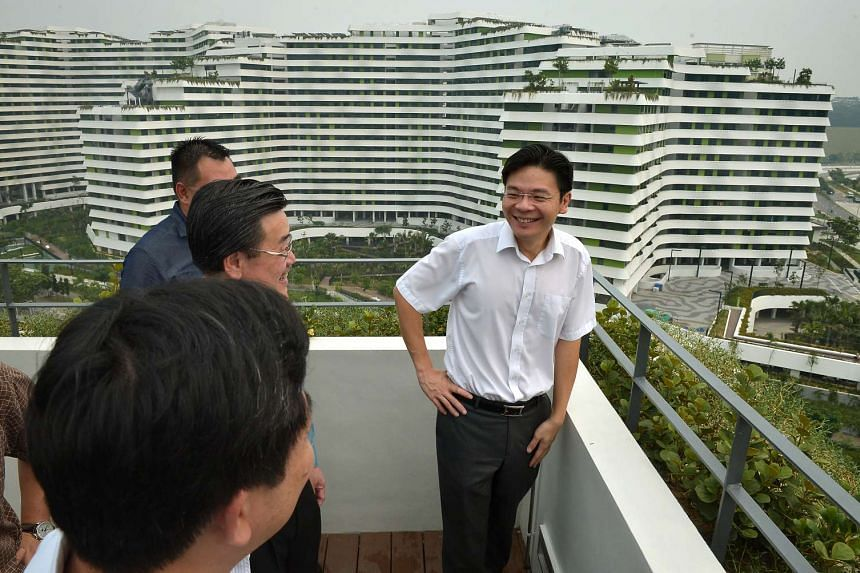Mr Lawrence Wong on a tour of the Waterway Terraces I project. He did not rule out the possibility of lifting certain measures ahead of others, but said ''it's premature to say what exactly we will unwind, what will happen''.