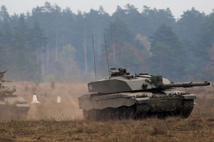 British army Challenger 2 tanks are seen manoeuvring during Nato military exercise Dragon-15 at the Land Forces Training Centre 'Orzysz' in Bemowo Piskie village, Masuria region, Poland, on Oct 16, 2015.