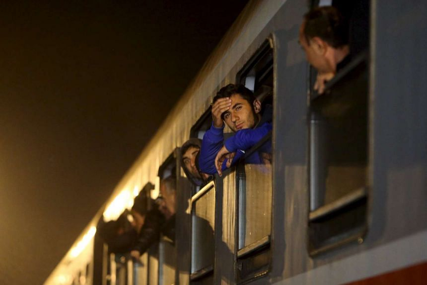 cap: Migrants waiting to exit a train at a train station in Sredisce ob Dravi, Slovenia, on Oct 17, 2015.