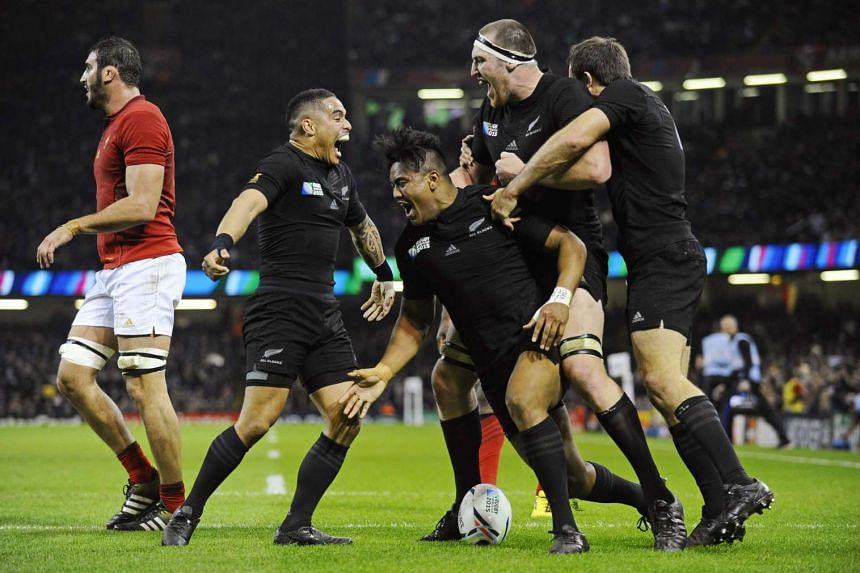 New Zealand players celebrating after Julian Savea (centre) scored a try during their Rugby World Cup match against France at  Millennium Stadium in Cardiff, Wales, on Oct 17, 2015.
