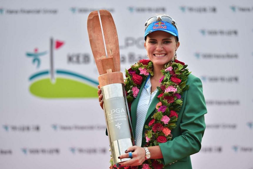 Lexi Thompson of the US poses with the trophy at the awards ceremony after winning the LPGA KEB Hana Bank Championship at the Sky72 Golf Club in Incheon, South Korea, on Oct 18, 2015.