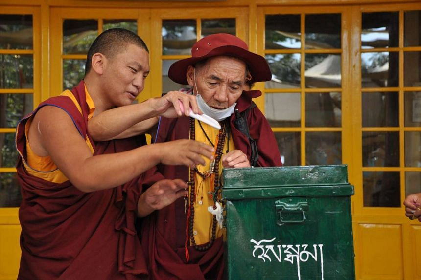 Tibetans living in exile cast their vote for the 16th Tibetan Parliamentary election at a polling station in Dharamsala, India, on Oct 18, 2015.