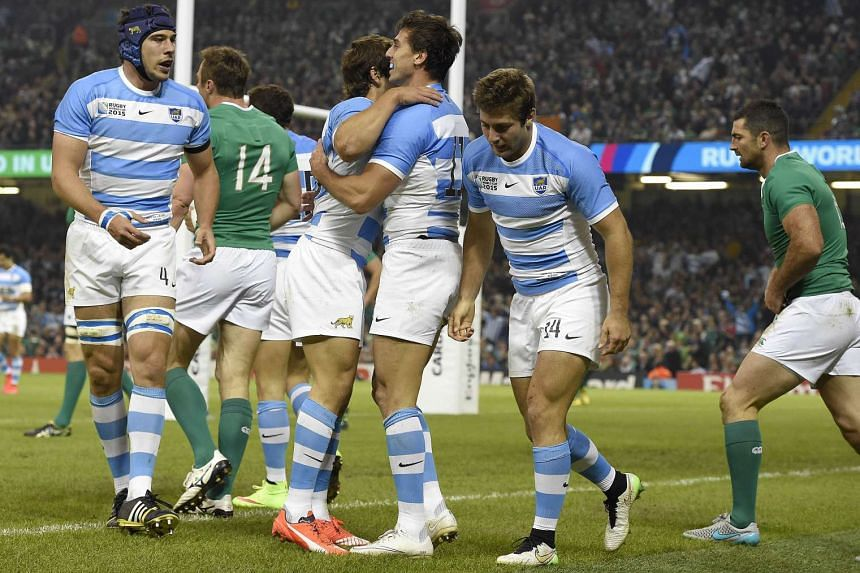 Argentina's wing Juan Imhoff (centre) celebrating after scoring his team's second try against Ireland during their Rugby World Cup quarter-final at Millennium Stadium in Cardiff, Wales on Oct 18, 2015.