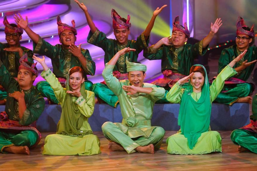 TV host Bryan Wong (centre) performing the Dikir Barat with other performers in a non-traditional routine.