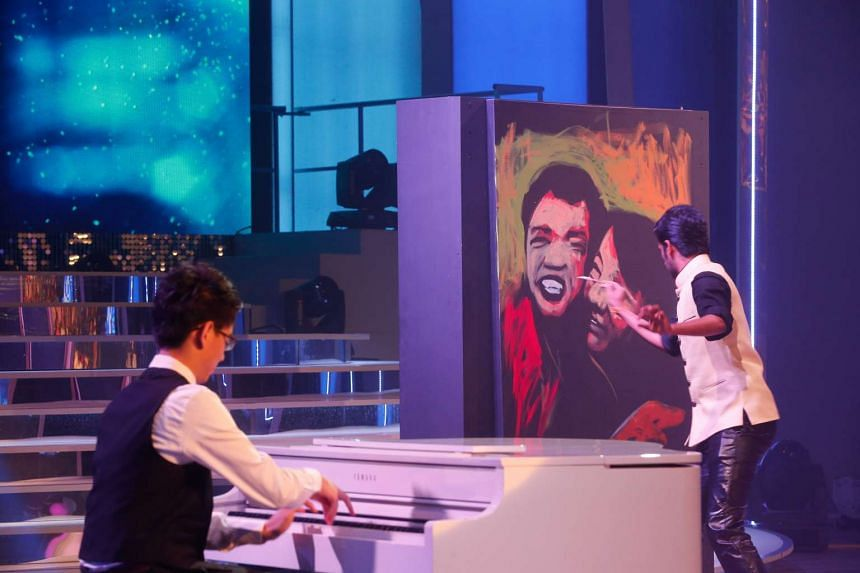 Speed painter Vilas Nayak painting an image of two beneficiaries  within three minutes while 15-year-old pianist Wang Hao Jia performs on the piano.