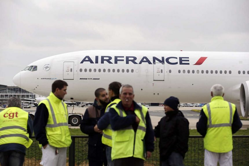 Air France employees demonstrating in front of the company headquarter in Roissy-en-France on Oct 5, 2015.
