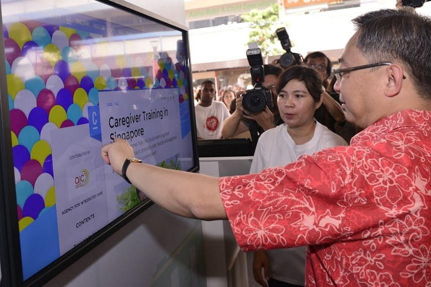 Minister for Health Gan Kim Yong viewing HealthHub features at the launch on Oct 18, 2015.