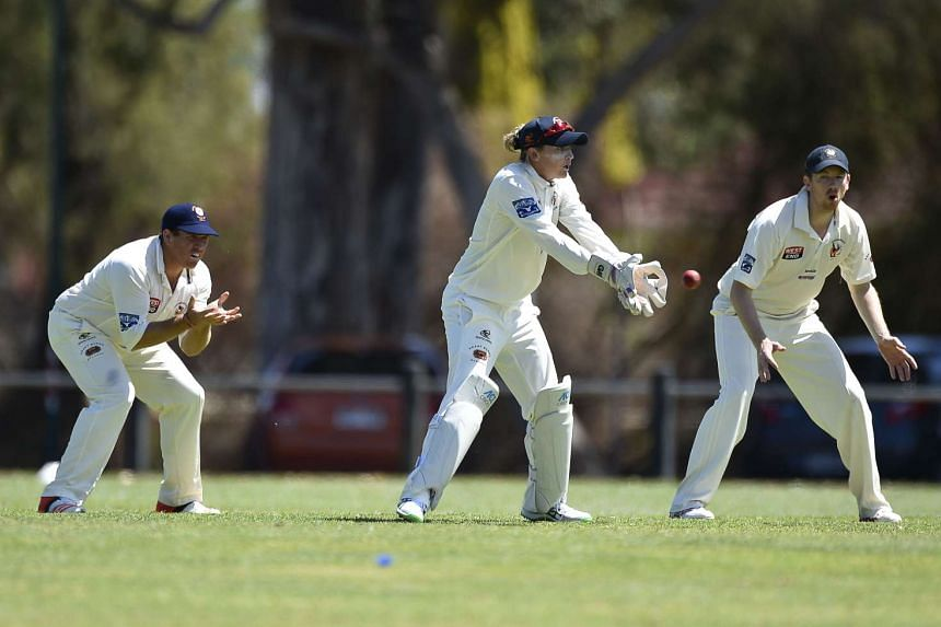 England international cricket keeper Sarah Taylor (centre), 26, fields during a game of men's grade cricket for Northern Districts in Adelaide on Oct 17, 2015.