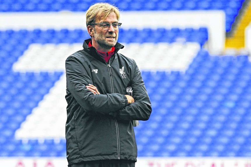 Liverpool's German manager Jurgen Klopp inspects the White Hart Lane pitch ahead of the English Premier League football match between Tottenham Hotspur and Liverpool at White Hart Lane in north London on Oct 17, 2015.