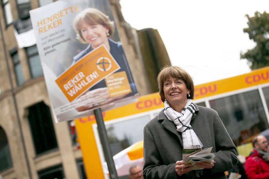 Picture taken on Oct 16, 2015 shows Henriette Reker (L), a prominent candidate for the mayoral election in Cologne, campaigning in Cologne, western Germany.