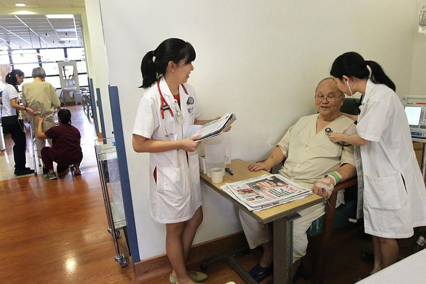 National University of Singapore (NUS) Medicine students with a patient. Eight weeks of their five-year course are devoted to geriatrics.