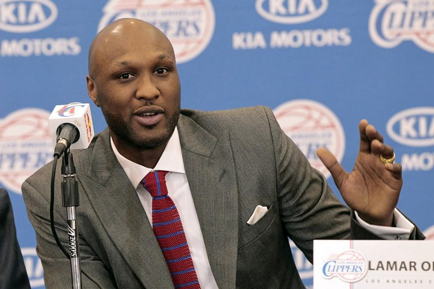 Lamar Odom, a two-time National Basketball Association champion and reality TV star fighting for his life after a brothel binge, regained consciousness in a Las Vegas hospital and was speaking on Friday.