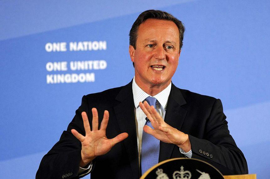 Britain's Prime Minister David Cameron gestures as he speaks in Leeds, Britain, on Sept 11, 2015.