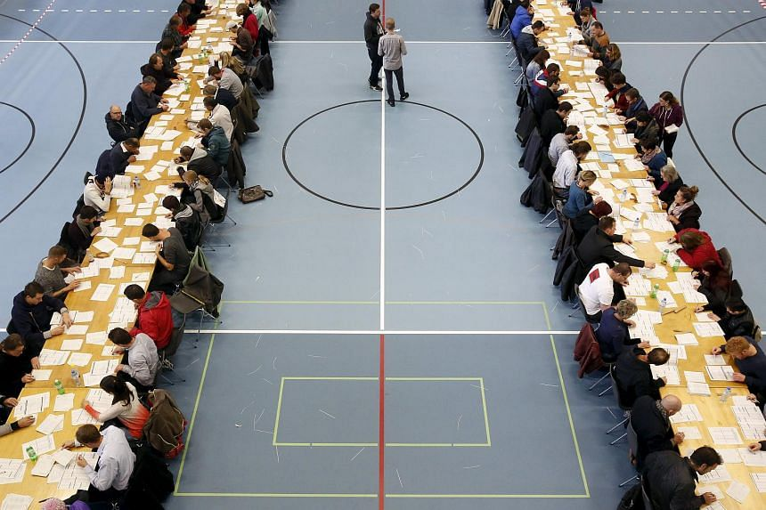 Citizens of Bern count votes at a gymnasium in Bern, Switzerland, on Oct 17, 2015.