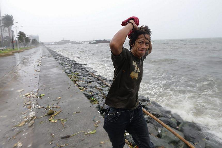 A Filipino walks along Manila Bay, in Manila, Philippines, on Oct 18, 2015.