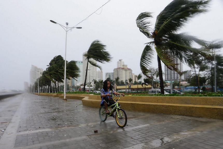 A Filipino rides a bicycle at Manila Bay in Manila, Philippines, on Oct 18, 2015.