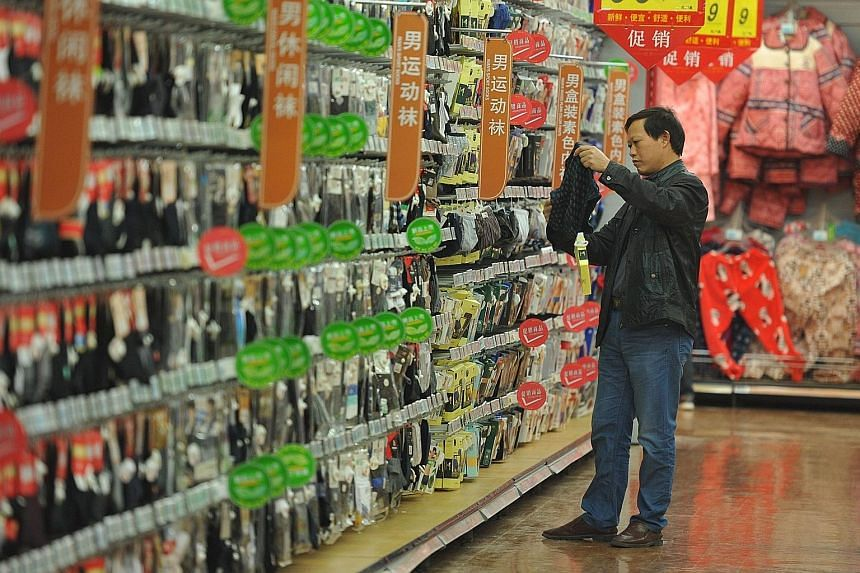 A customer browsing in a supermarket in Fuyang, China's Anhui province. China is at the centre of the stock market drama, where the slowing economy has continued to unnerve investors.