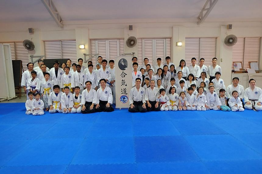 Mr Patrick Chan (front row, seventh from left) and his martial arts students at the first anniversary of Aikido Tai Shin Kai.