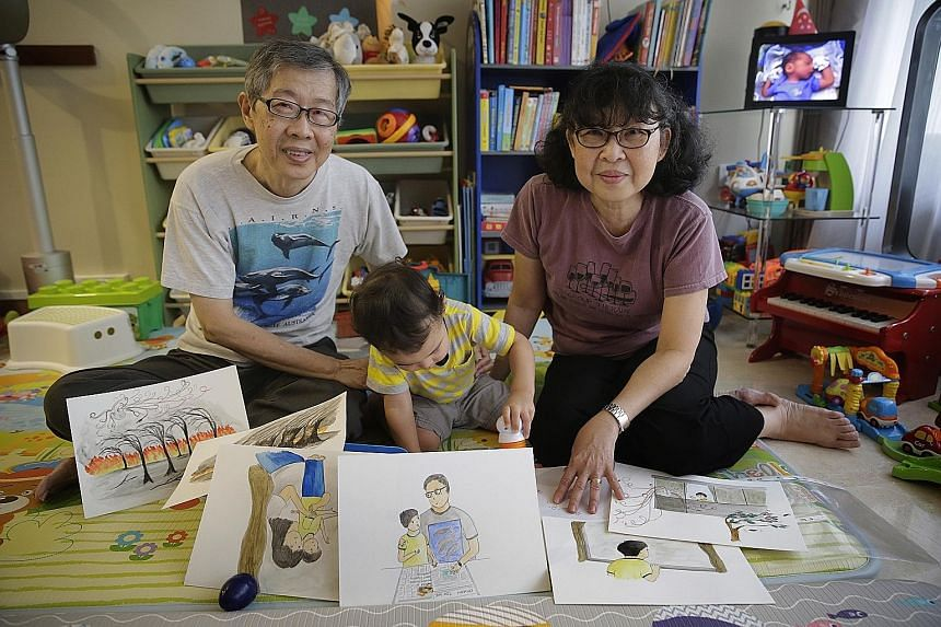 Retirees Khoo How San and Angeline Khoo with their grandson Matthew, who inspired them to write Matthew And The Horrid Haze.