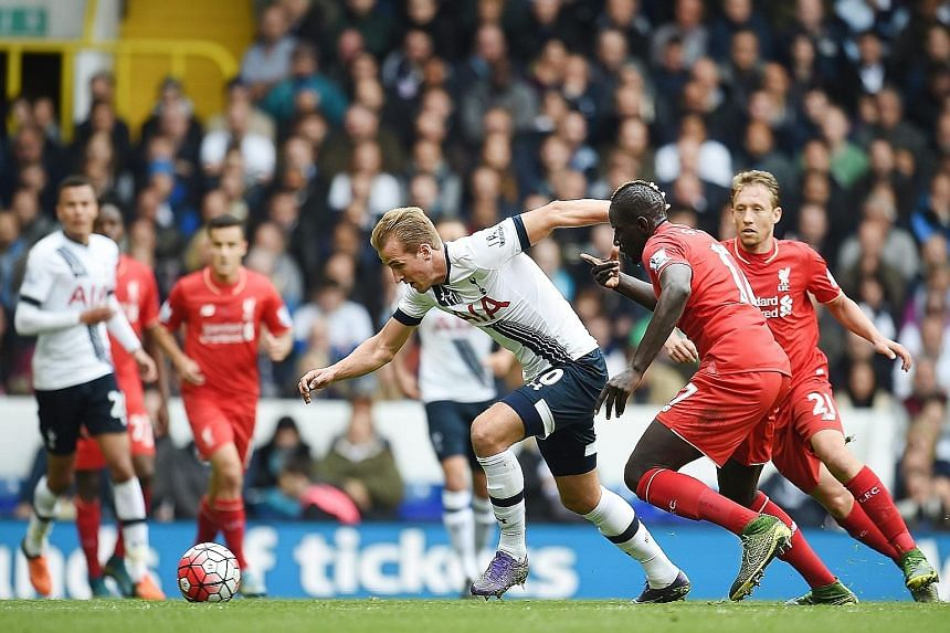 Tottenham's Harry Kane (left) vies for the ball with Liverpool's Mamadou Sakho during the 0-0 draw at White Hart Lane yesterday.