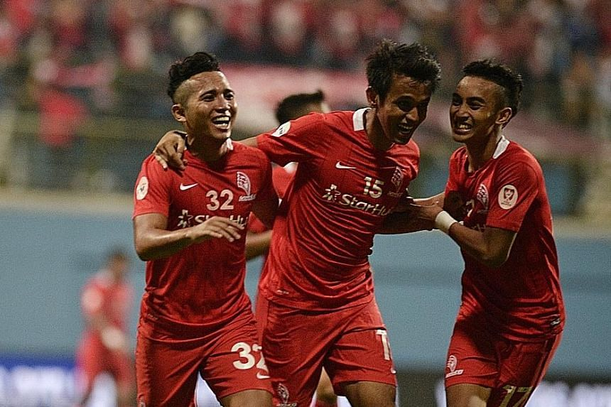 Shahdan Sulaiman (centre), celebrating with Sahil Suhaimi (left) and Faris Ramli. His goal proved enough to see off visitors Johor Darul Takzim II and propel the LionsXII to the top of their group.