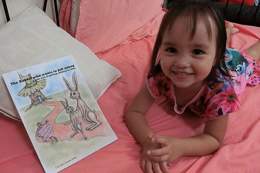Toddler Leah (left) was not impressed by The Rabbit Who Wants To Fall Asleep, a book that claims to send children to sleep.