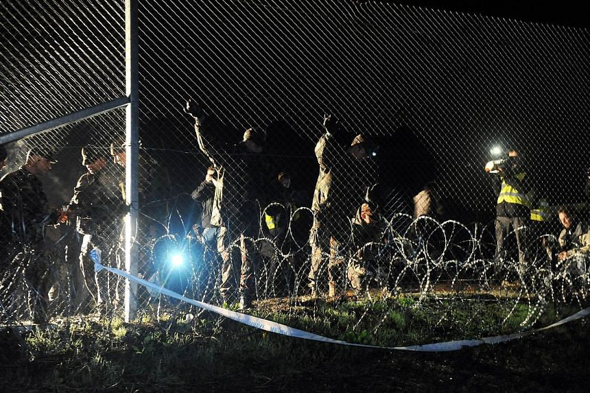 Hungarian police and soldiers closing the Hungary-Croatia border on Friday.