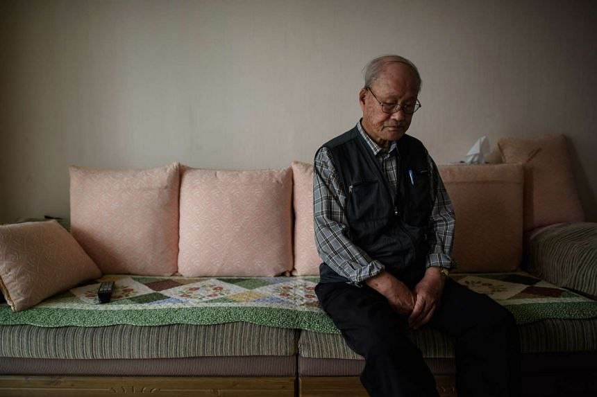 In a photograph taken on Oct 16, 2015 Park Yun-Dong, 90, sits in his apartment in Ansan, south of Seoul.