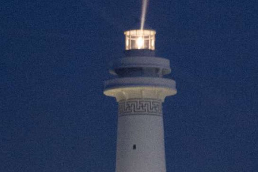 Huayang Lighthouse is pictured during an inauguration ceremony in the South China Sea, in this picture released by China's official Xinhua News Agency dated Oct 9, 2015.