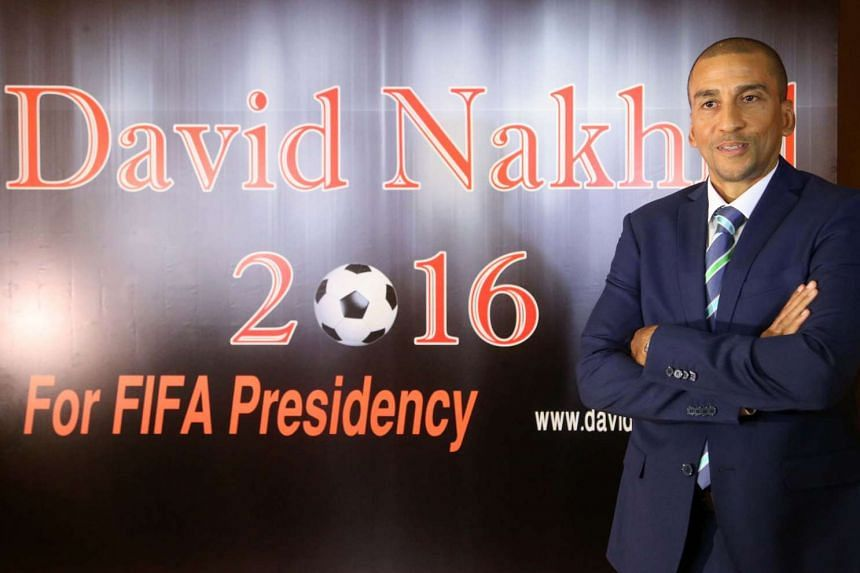 Former Trinidad and Tobago football player David Nakhid poses in front of a poster during a press conference to launch his bid for the Fifa presidency, in Beirut on Sept 28, 2015.
