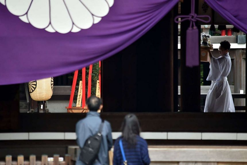 People visit the controversial Yasukuni shrine during the shrine's autumn festival in Tokyo on Oct 17, 2015.
