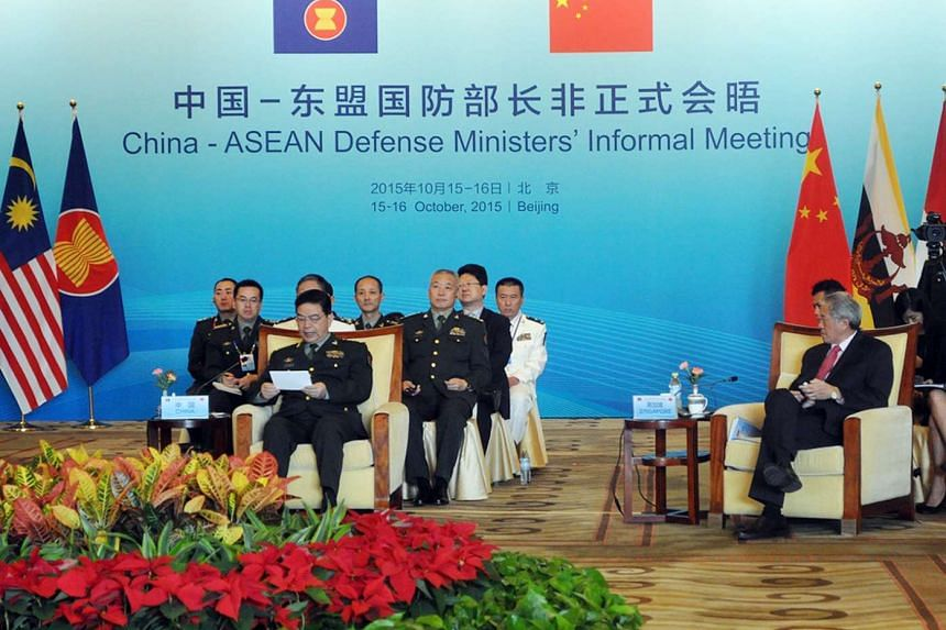 Defence Minister Ng Eng Hen (right) and China's Defence Minister Chang Wanquan (left, front row) at the inaugural China-Asean defence ministers' informal meeting in Beijing on Oct 16, 2015.