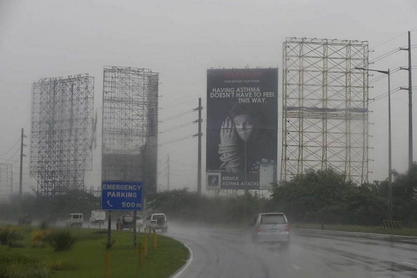 Giant billboards were stripped off their structures in the Bulacan province of Philippines as Typhoon Koppu approaches. A resident said that soldiers are going around coastal villages, forcing people to flee.