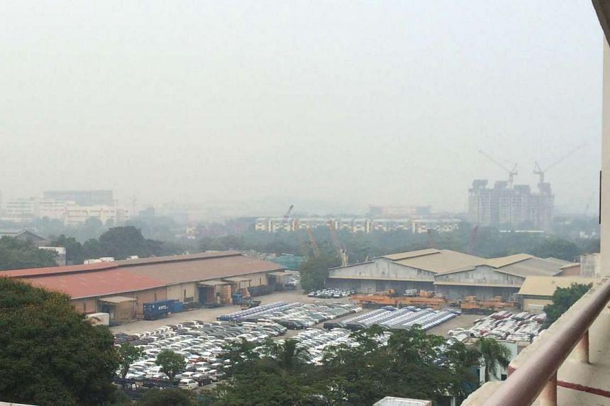 A slight haze is seen at Teban Gardens at 8am on Oct 19, 2015.