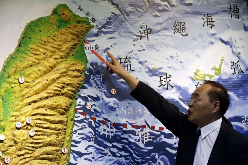 Kuo Kai-Wen, director of the Seismology center, points at a map to show where a magnitude 5.2 earthquake shook parts of Taiwan, at the Central Weather Bureau in Taipei on 19 Oct, 2015.